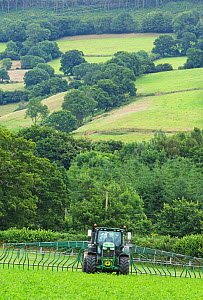 Farmer spreading slurry on organic dairy land. Slurry collected from the cattle herd is recycled as natural fertiliser, Devon, England, UK, July.  -  Matthew Maran