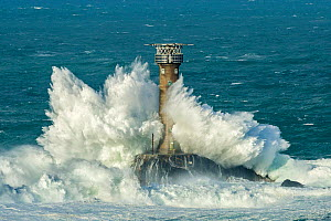 Waves crashing against Longships Lighthouse, Land's End, Cornwall, England, UK. February 2015. - Guy Edwardes