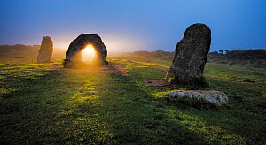 Sunrise through stone at Men-An-Tol, Morvah, Cornwall, England, UK. September 2016.  -  Guy Edwardes
