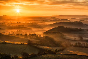 Sunrise over the Marshwood Vale, West Dorset from Quar Hill, Chideock, Dorset, England, UK. May 2013. - Guy Edwardes