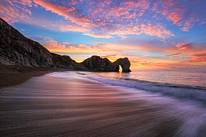 Durdle Door at sunrise, Jurassic Coast, Dorset, England, UK. December 2014. - Guy Edwardes