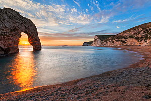 Durdle Door and Bats Head at sunset, Jurassic Coast, Dorset, England, UK. December 2014. - Guy Edwardes