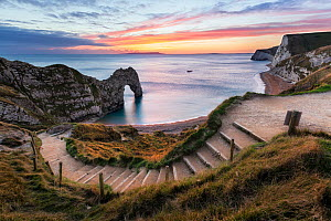 Durdle Door, Dungy Head and Bats Head at sunset, Isle of Portland on horizon, Jurassic Coast, Dorset, England, UK. December 2014. - Guy Edwardes
