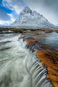 Waterfall with Buachaille Etive Mor in background, Glen Coe, Highlands, Scotland, UK. January 2014. - Guy Edwardes