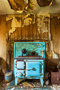 Stove in abandoned cottage, Isle of Harris, Outer Hebrides, Scotland, UK. March 2014. - Guy Edwardes