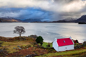 Red roofed croft overlooking Loch Sheildaig, Loch Torridon, Applecross Peninsula, Highlands, Scotland, UK. January 2015. - Guy Edwardes