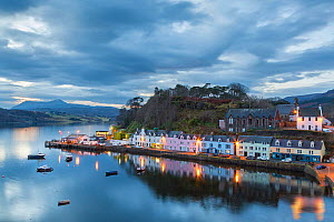 Coastal cottages at twilight, Portree, Isle of Skye, Inner Hebrides, Scotland, UK. January 2014. - Guy Edwardes