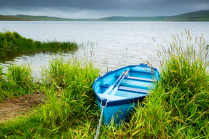 Boat at edge of Loch of Spiggie, Shetland, Shetland Isles, Scotland, UK. July 2014. - Guy Edwardes