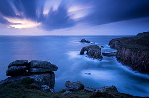 RF - Storm approaches Enys Dodnan Arch, the Armed Knight rock, and Longg Ships lighthouse at Land's End, Cornwall, UK. September 2016. (This image may be licensed either as rights managed or royalty f...  -  Ross Hoddinott