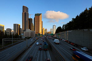 Interstate 5 and the Seattle skyline viewed from the Yesler Way overpass at sunrise.  Washington, USA. April 2017. - Kirkendall-Spring