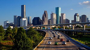 Timelapse of traffic on a highway, with Houston skyline in the background, Texas, USA, June 2016. Hellier  -  Gavin Hellier