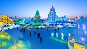 Timelapse from day to night of people visiting the illuminated ice sculptures at the Harbin Ice and Snow Festival, Heilongjiang Province, China, February 2015. (This image may be licensed either as ri...  -  Gavin Hellier