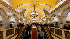 Timelapse of commuters using escalators in Moscow's Komsomolskaya metro station, showing vaulted ceiling and chandeliers, Russia, May 2016. (This image may be licensed either as rights managed or roya...  -  Gavin Hellier