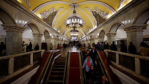 Commuters using escalators in Moscow's Komsomolskaya metro station, showing vaulted ceiling and chandeliers, Russia, May 2016. (This image may be licensed either as rights managed or royalty free.)  -  Gavin Hellier