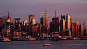 View of Manhattan at dusk across the Hudson River, New York, USA, June 2016. (This image may be licensed either as rights managed or royalty free.) - Gavin Hellier