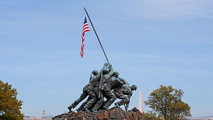 Timelapse from day to night of an American flag fluttering on the Iwo Jima Memorial, Washington DC, USA, June 2016. (This image may be licensed either as rights managed or royalty free.) - Gavin Hellier