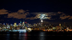 Timelapse of the moon rising over Manhattan, New York, USA, June 2016. (This image may be licensed either as rights managed or royalty free.) - Gavin Hellier