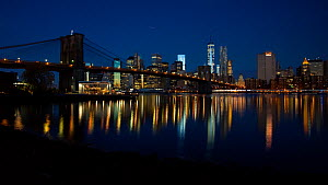 Timelapse from night to day looking towards Brooklyn Bridge, New York, USA, June 2016. (This image may be licensed either as rights managed or royalty free.) - Gavin Hellier
