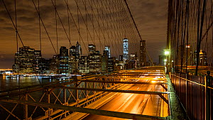 Timelapse of traffic crossing Brooklyn Bridge at night, New York, USA, June 2016. (This image may be licensed either as rights managed or royalty free.) - Gavin Hellier