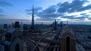 Wide angle timelapse from day to night of the Dubai Interchange, with the Burj Khalifa in the background, Dubai, United Arab Emirates, January 2017. (This image may be licensed either as rights manage... - Gavin Hellier