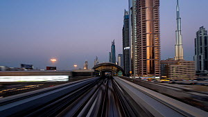 Timelapse looking out of the front of a train on the elevated Dubai Metro System, Dubai, United Arab EmiratesJanuary 2017. (This image may be licensed either as rights managed or royalty free.)  -  Gavin Hellier