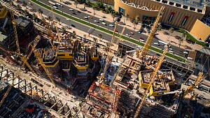 Timelapse looking down onto cranes moving on a construction site, Dubai, United Arab Emirates, January 2017. (This image may be licensed either as rights managed or royalty free.) - Gavin Hellier