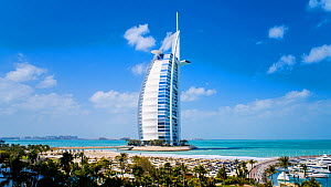 Timelapse of clouds moving over the Burj Al Arab Jumeirah hotel, Dubai, United Arab Emirates, January 2017. (This image may be licensed either as rights managed or royalty free.) - Gavin Hellier