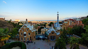 Timelapse from day to night looking over the Gaudi House Museum, Barcelona, Catalonia, Spain, May 2016. (This image may be licensed either as rights managed or royalty free.) - Gavin Hellier