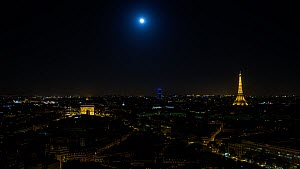 Timelapse of the moon rising over Paris at night, with the Eiffel Tower in the background, Paris, France, May 2016. (This image may be licensed either as rights managed or royalty free.) - Gavin Hellier