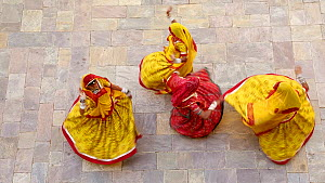 Four women dancing whilst wearing saris, Samode Palace, Jaipur, Rajasthan, India, Model and Property released, January 2018. (This image may be licensed either as rights managed or royalty free.) - Gavin Hellier
