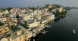 Aerial shot over Lake Pichola and the City Palace, Udaipur, Rajasthan, India, January 2018. (This image may be licensed either as rights managed or royalty free.) - Gavin Hellier