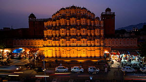 Timelapse from day to night of traffic moving past the Hawa Mahal, (Palace of the Winds), Jaipur, Rajasthan, India, January 2018. (This image may be licensed either as rights managed or royalty free.) - Gavin Hellier