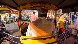Timelapse from the back of an autorickshaw moving through city streets, Udaipur, Rajasthan, India, January 2018. (This image may be licensed either as rights managed or royalty free.)  -  Gavin Hellier