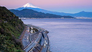 Timelapse of traffic driving on the Tomei Expressway at dusk, with Mount Fuji in the background, Shizuoka, Honshu, JapanNovember 2017. (This image may be licensed either as rights managed or royalty f... - Gavin Hellier