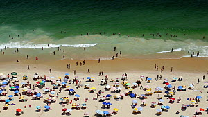 People swimming and sunbathing on Copacabana beach, Rio de Janeiro, Brazil, September 2016. (This image may be licensed either as rights managed or royalty free.) - Gavin Hellier