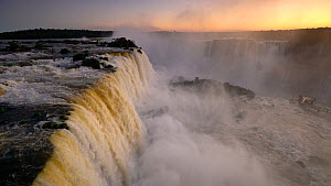 Wide angle shot of Iguazu Falls at sunset, Iguazu National Park, Brazil, September 2016. (This image may be licensed either as rights managed or royalty free.) - Gavin Hellier