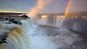 Wide angle shot of Iguazu Falls at sunset, with rainbow, Iguazu National Park, Brazil, September 2016. (This image may be licensed either as rights managed or royalty free.) - Gavin Hellier