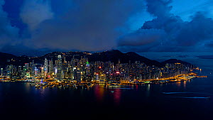 Timelapse from day to night looking towards Hong Kong harbor, Central district and Victoria Peak, Hong Kong Island, China, June 2017. (This image may be licensed either as rights managed or royalty fr... - Gavin Hellier