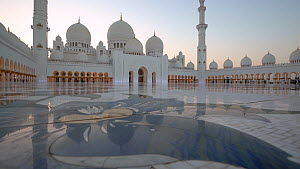 Panning track shot across the courtyard of the Sheikh Zayed Grand Mosque, Abu Dhabi, United Arab Emirates, December 2017. Hellier  -  Gavin Hellier