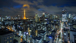 Timelapse of clouds moving over Tokyo at night, Tokyo, Japan, November 2017. (This image may be licensed either as rights managed or royalty free.)  -  Gavin Hellier