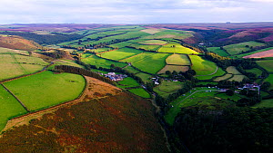 Aerial shot tracking over Exmoor National Park, showing moors and farmland, Devon, England, UK, October 2017. (This image may be licensed either as rights managed or royalty free.) - Gavin Hellier