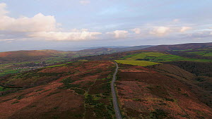 Aerial view tracking over Exmoor National Park, towards Porlock, Somerset, England, UK, October 2017. (This image may be licensed either as rights managed or royalty free.) - Gavin Hellier