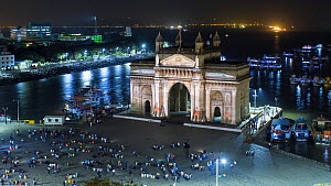 Timelapse of people watching projections on the Gateway of India at night, Mumbai, Maharashtra, India, January 2018. (This image may be licensed either as rights managed or royalty free.)  -  Gavin Hellier
