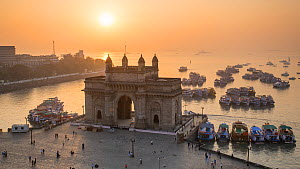 Timelapse of the sun setting behind the Gateway of India, Mumbai, Maharashtra, India, January 2018. (This image may be licensed either as rights managed or royalty free.)  -  Gavin Hellier