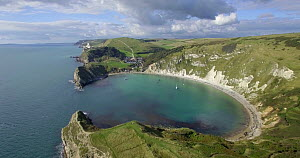 Aerial shot tracking over Lulworth Cove, Dorset, England, UK, May 2017. (This image may be licensed either as rights managed or royalty free.) - Gavin Hellier
