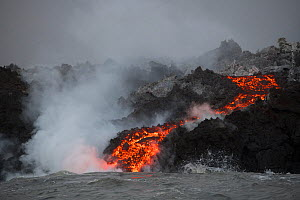 A'a lava entering the ocean, emanating from Fissure 8 of the Kilauea Volcano, Cape Kumukahi, Kapoho, Puna District, Hawaii. June 2018. - Doug Perrine