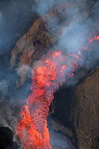 Lava erupting from fissure 8 of the Kilauea Volcano, boiling out of cinder cone.  East rift zone in Leilani Estates, near Pahoa, Puna District, Hawaii. June 2018. - Doug Perrine