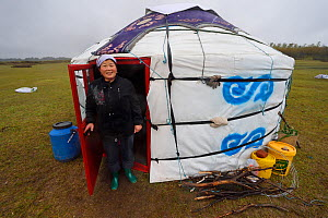 Mongolian shepherd and school teacher Qi Qi Ge, outiside her daughter's tent or Yurt, Inner Mongolia, China. May 2016  -  Staffan Widstrand / Wild Wonders of China
