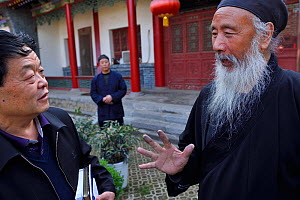 Tao Grand Master Rinfarong, explaining about Taoism for us, at the Louguantai temple, Xian, Shaanxi, China. This temple is where Lao Tze wrote the Tao Te Ching. - Staffan Widstrand / Wild Wonders of China