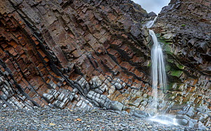 A small waterfall at Sandy Mouth beach, near Bude, Cornwall, UK, March. The rocks are steeply dipping Carboniferous age, sandstone and shale (Culm Measures). - Graham Eaton